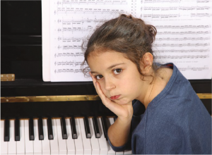young-girl-unhappy-about-piano-practice
